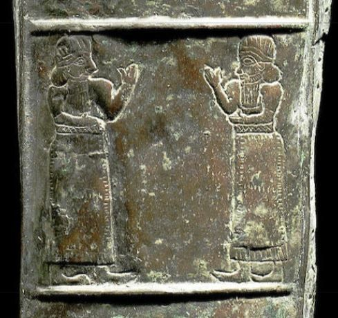 Luristan bronze quiver, 10th-8th century B.C. Luristan bronze quiver, decorated in repoussé and incision, detail of register representing two bearded men facing each other. This style is probably from a provincial workshop that copy Assyrian model with Achaemenid influence. Private collection