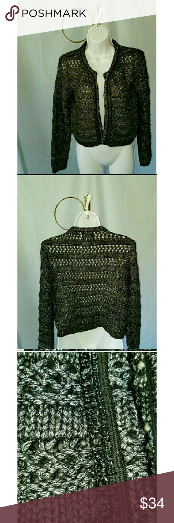"""GUESS SPARKLY BLACK AND SILVER CARDIGAN GUESS SPARKLY BLACK AND SILVER CARDIGAN has an open front with chain links used as trim around the opening.   Size Small 29% polyester 26% wool and 19% metallic.  Armpit to armpit is 18. 75 """" and shoulder to hem length is 18.5"""".All measurements are approximate and taken flat Guess  Sweaters Cardigans"""