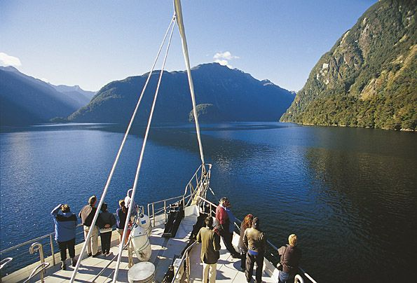 Taking a cruise on Milford Sound. Look out for those waterfalls on a rainy day.
