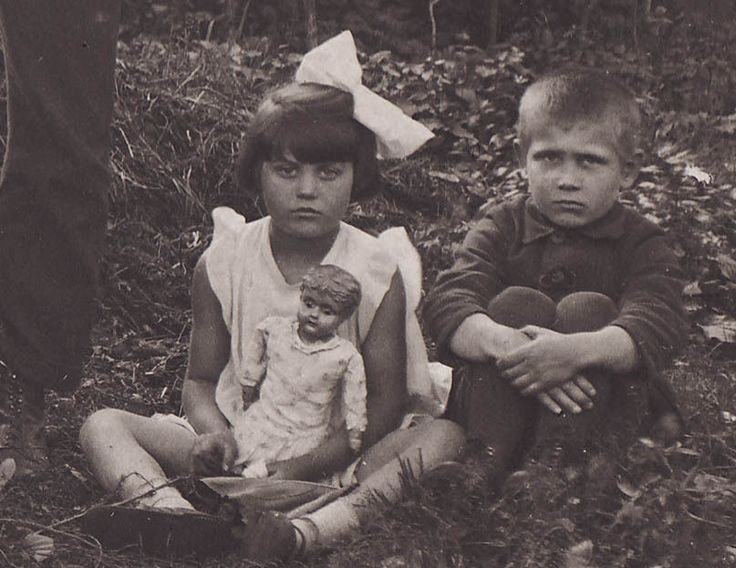 VINTAGE:  Two children from Estonia, girl holding doll