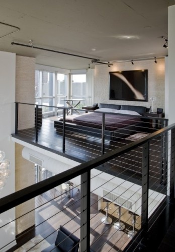 The biggest changes in the home happened upstairs. This loft originally consisted of two small bedrooms, which Charalambous transformed into an open master bedroom and study suite that overlook out the atrium.