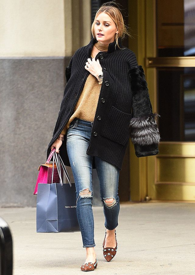 Olivia Palermo in a camel sweater, black cardigan, skinny jeans and flats.