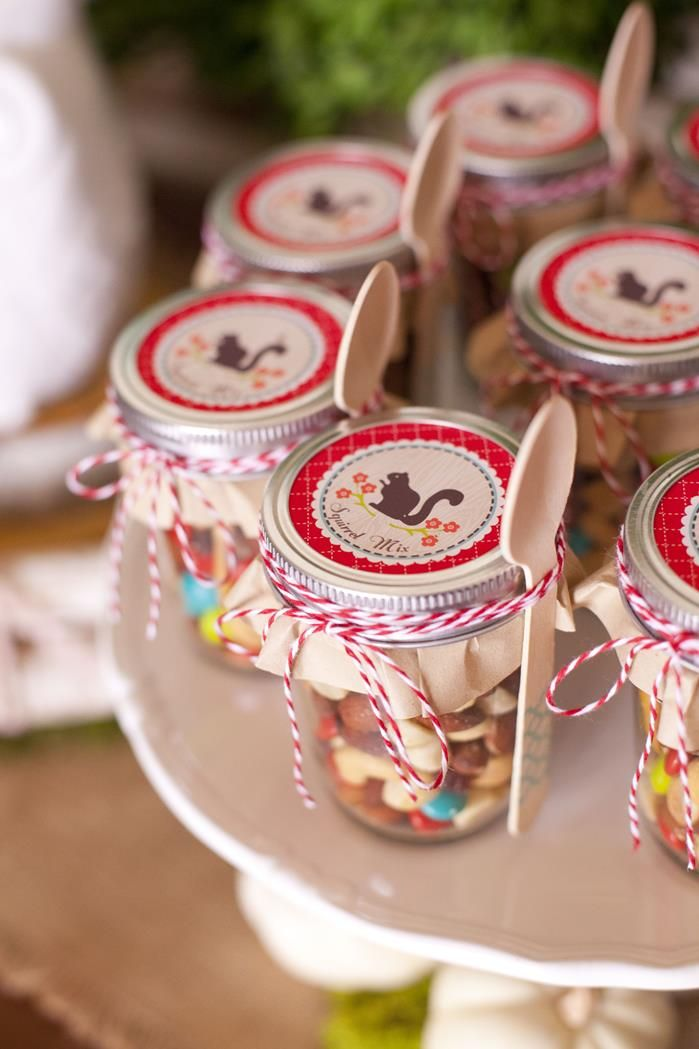 Trail mix party favors in jars. Cute! Woodland Owl Party via Kara's Party Ideas   KarasPartyIdeas.com #OwlParty #WoodlandParty #Owlpartysupplies