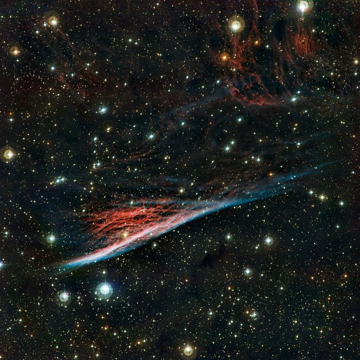The Pencil Nebula. This image from the Wide Field Imager on the MPG/ESO 2.2-metre telescope at ESO's La Silla Observatory in Chile shows the Pencil Nebula against a rich starry background. This oddly shaped cloud, which is also known as NGC 2736, is a small part of a supernova remnant in the southern constellation of Vela (The Sails). These glowing filaments were created by the violent death of a star that took place about 11 000 years ago. The brightest part resembles a pencil; hence the name.The Chairs, Eso La, Cosmo, Final Frontier, Nebulas Ngc, Witches Broom, Ngc 2736, Pencil Nebulas, Outer Spaces