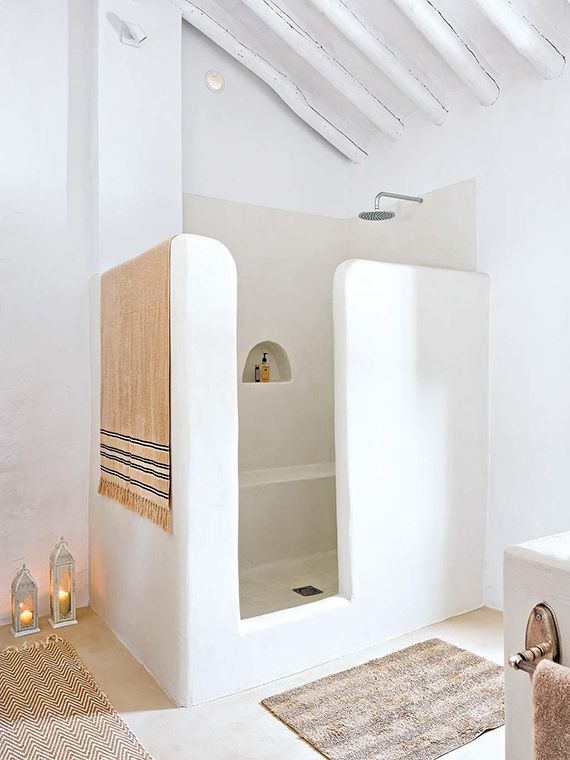 Modern, white country bathroom with Greek inspiration. Add Mirage LED candles to the lanterns so they can be set to automatically light each evening.