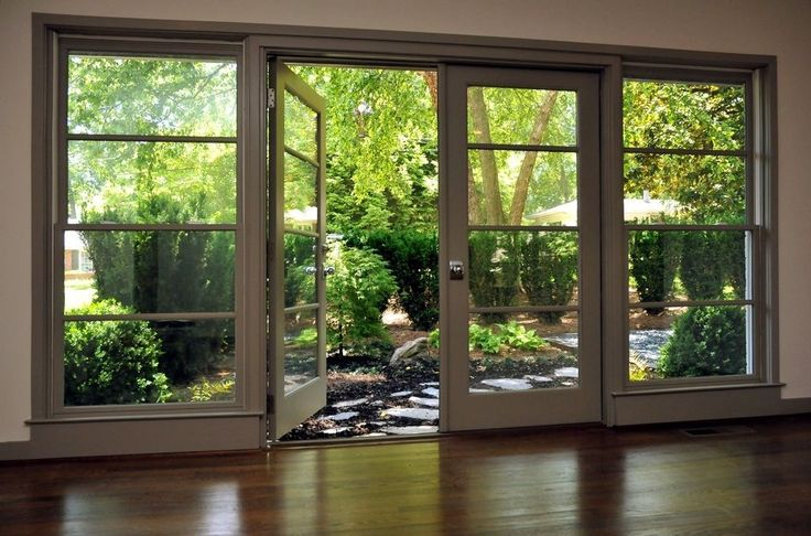Modern French doors aside the home to go to the garden
