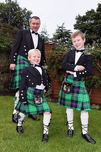 Wedding guests all handsome young men in kilts at a Wedding in Edinburgh, Scotland.  Photo: weddingphotography.com