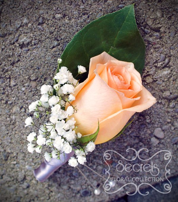 Fresh peach rose and baby's breath boutonniere, with silver satin wrap