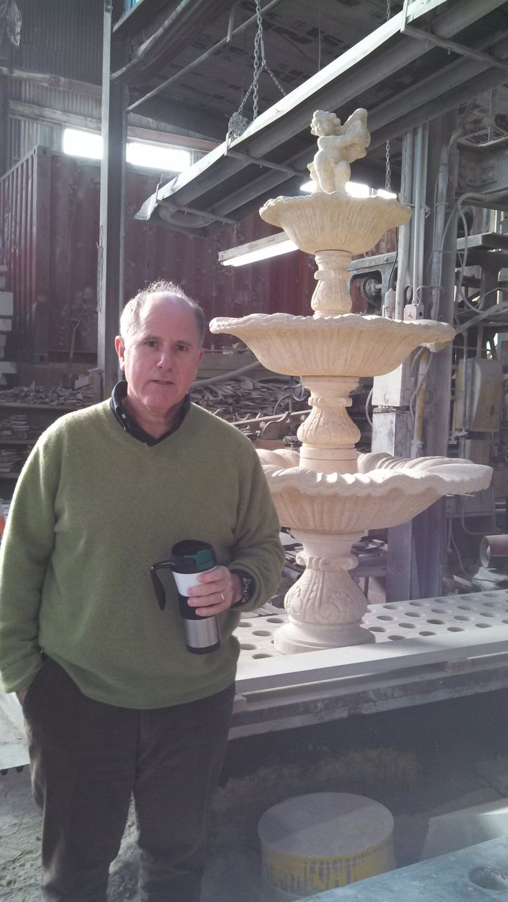 Ralph Petrillo, alongside hand carved French Limestone Fountain