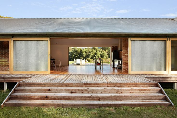 Full length sliding glass doors open through a holiday home