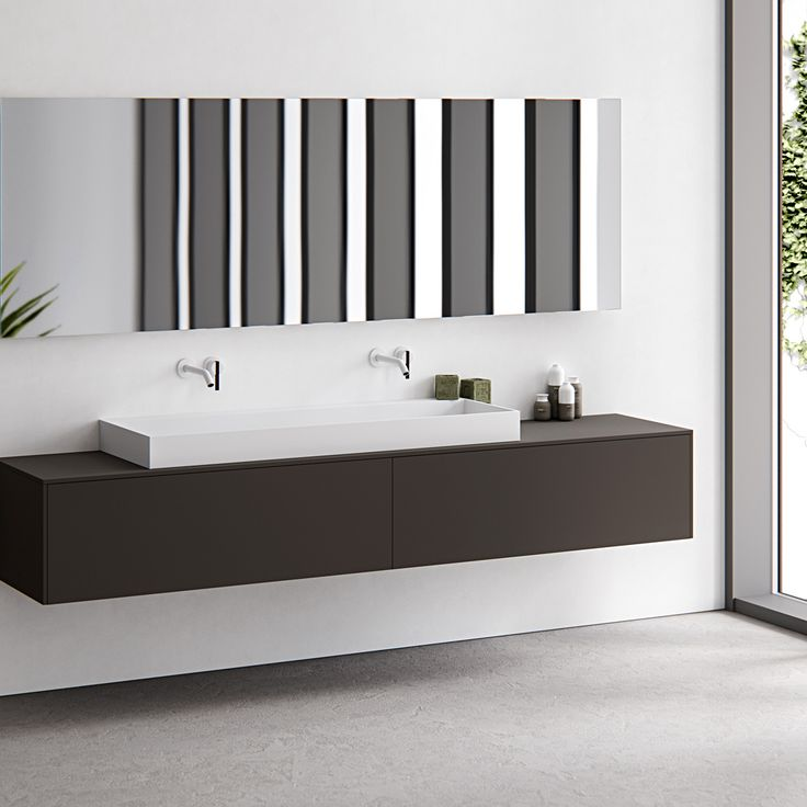 Edge, simple yet sophisticated and characterised by its minimalist rectangular appearance and thin 12mm edge. A completely (hand) made to measure basin out of HI-MACS (solid surface). This basic-shaped basin is ideal for design purposes and easily adaptable. Featured: Edge top mounted washbasin in Alpine white HI-MACS on top of a Fenix NTM wall mounted cabinet. Divide the basin in two and cover the waste with the divide inlay platform. bathsbyclay.com