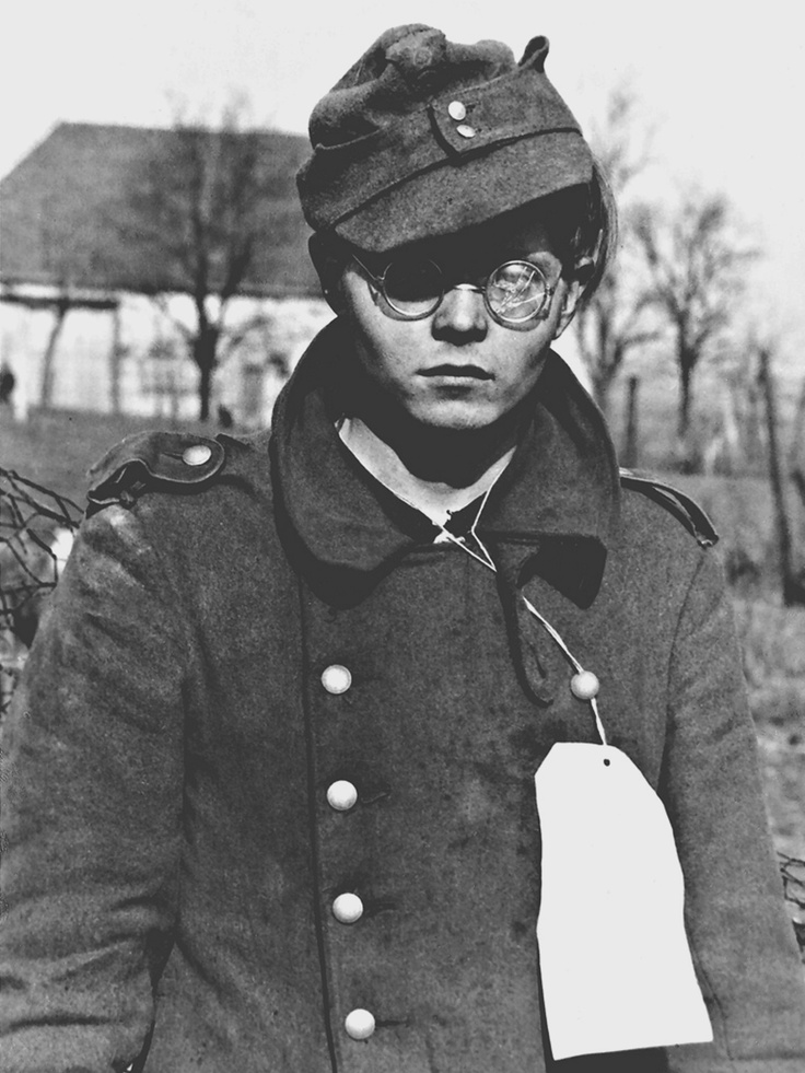 Teenage German soldier, who served with the Hitlerjugend division, is taken prisoner by US troops near Forbach (Alsace), March 1945.