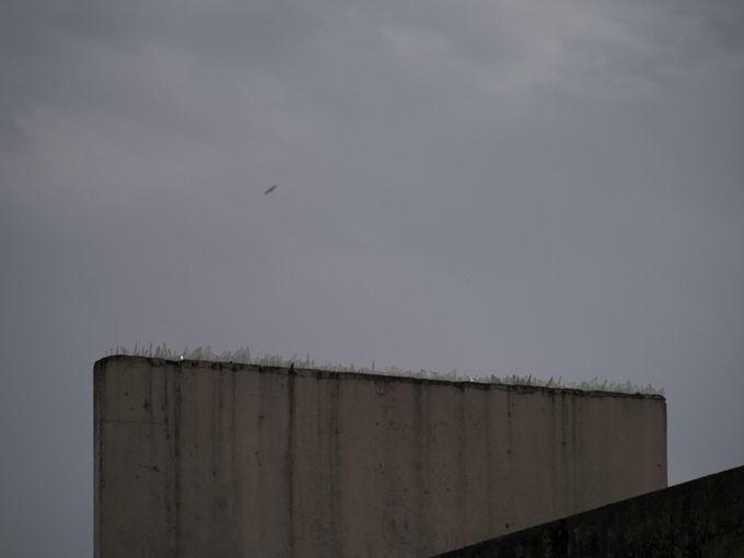 """Hamza Halloubi /  Horizon 2011 / This photo is taken in Tangier of a wall built at the top of a building. This is a wall against immigration and glances. The name of the photo is """"horizon"""" and it refers to the one next to the wall who wants to pass through."""