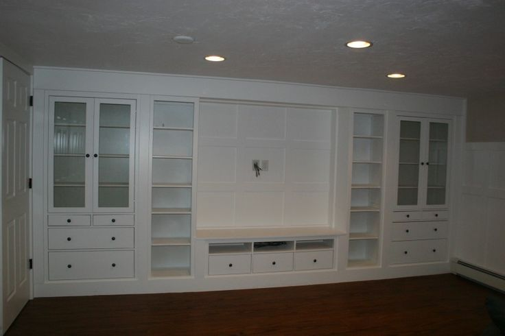 Amazing IKEA hack ~ We were looking for a built in in our basement family room so we chose some pieces from the Hemnes line, spaced them apart and finished the tops, bottoms and spaces in between to make it look like one large unit. ~ Ikea Hackers#Repin By:Pinterest++ for iPad#