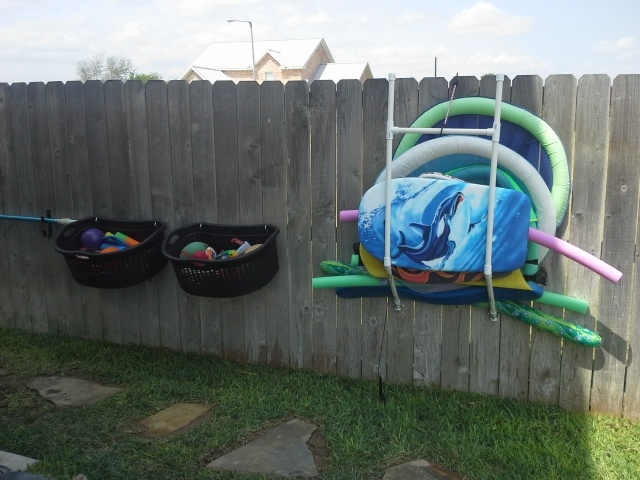 Organize Pool Toys In Pvc Rack And Laundry Baskets Mounted