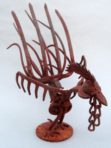 Rusty Rooster.  Using retired hand tools, pitch fork and rake heads, rebar, chains and other discarded metal scraps, Shamus forms this amazing work of art.