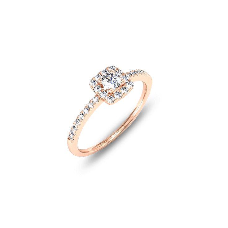 Pavée de diamants, cette bague de fiançailles est composée d'une pierre centrale ronde de 0,10 ou 0,20 carats, sur une monture rectangulaire. Un brin vintage, cette création a le pouvoir de transformer en princesse, d'un simple effleurement. Un sublime bijou aérien, d'une délicatesse et d'une grâce sans égales.