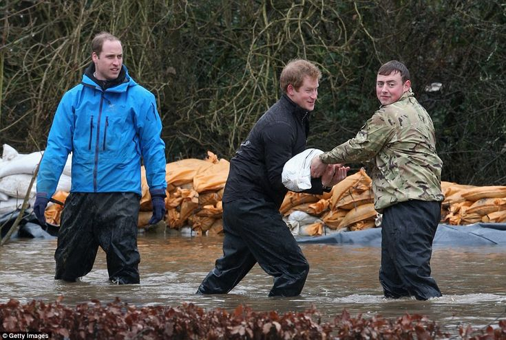 Royals to the rescue: On Friday, Prince William and Prince Harry helped flood-hit Brions protect their homes, unloading sandbags alongside s...