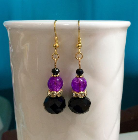 Lovely Swarovski glass crystal earrings in black, purple and gold tones. $9 Australia Bling yourself.