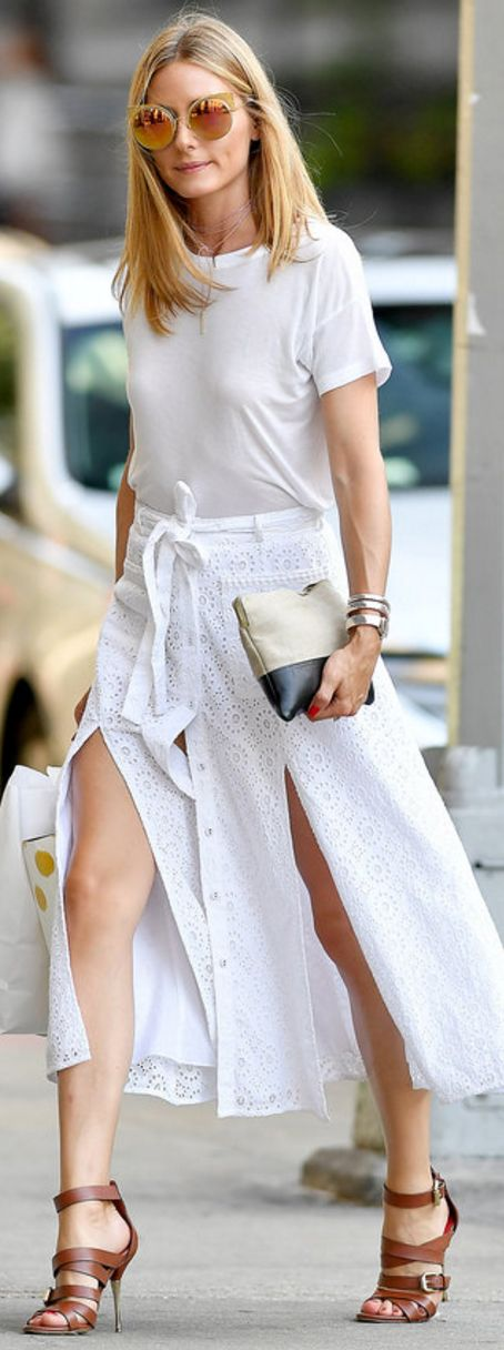 Who made  Olivia Palermo's brown sandals, white button skirt, pink jewelry, gold watch, black clutch handbag, and white top?
