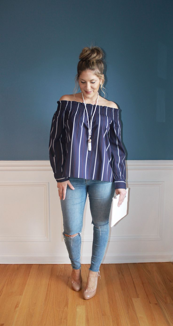 off the shoulder top, distressed denim, white clutch, top knot, spring fashion