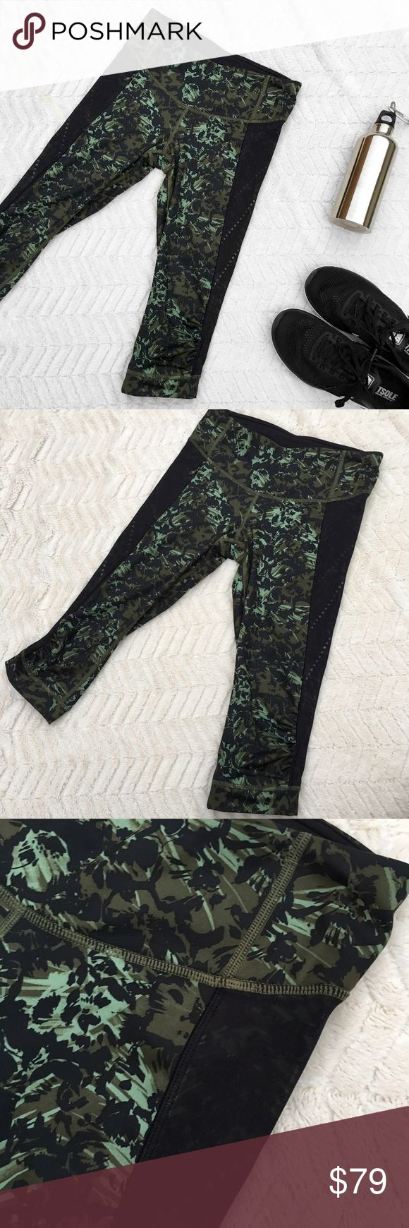 "Lululemon Athletica Stop at Nothing Camo Leggings Lululemon Athletica • Style is called ""Stop At Nothing"" • Size 4 • Measurements: Waist: 25"". Leg inseam: 18"" long. • Green camouflage design with black mesh paneling / color blocking on the sides • 3/4 length capris / cut offs • Zipper pocket on the right side • In absolutely perfect condition except that the inside tag was cut off because it was itchy • Lululemon logo at the lower back portion • Cinch waist • Slight gathering / cinching…"