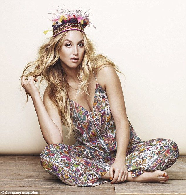 Tribal chic: Whitney Port wears a patterned jumpsuit with a feathered headband for the Company magazine shoot