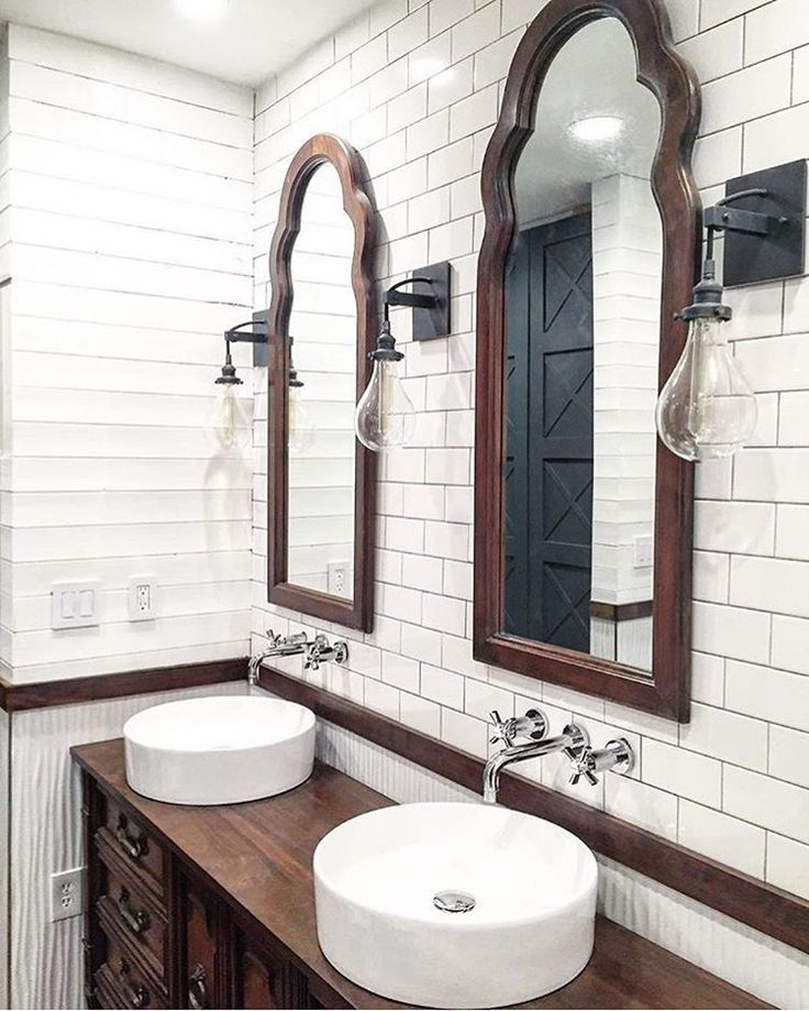 In awe of this gorgeous bathroom renovation from @beginninginthemiddle! And I love those black paneled doors peeking in the mirror reflection! Use #imaremodelaholic to share your projects and for a chance to be featured!
