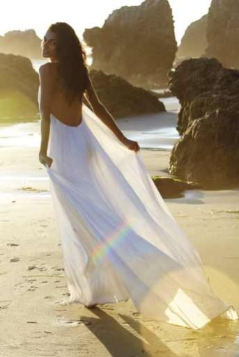 White sheer flowy dresses are perfect for a summer beach boudoir session. Add a splash of water for more sensual wet look