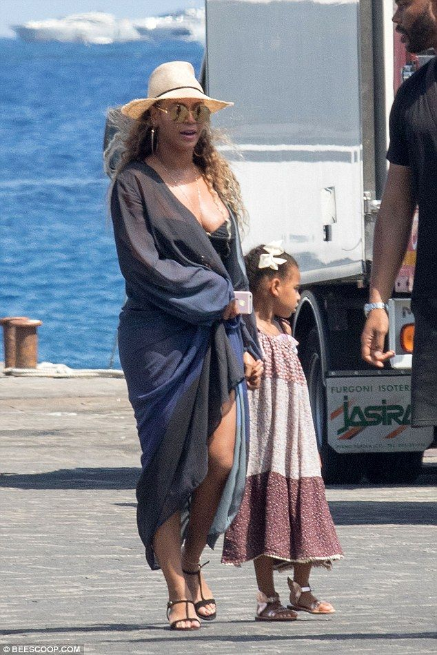 Mini-me: Little Blue Ivy was also in tow, looking cute in a burgundy summer dress