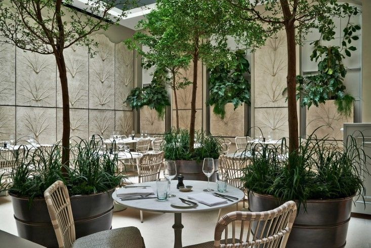 Skye asked garden designer Jinny Blom to make a garden-like space within the bigger restaurant. It's a plant-filled atrium, with repeated reliefs of leafy gunnera along the walls.