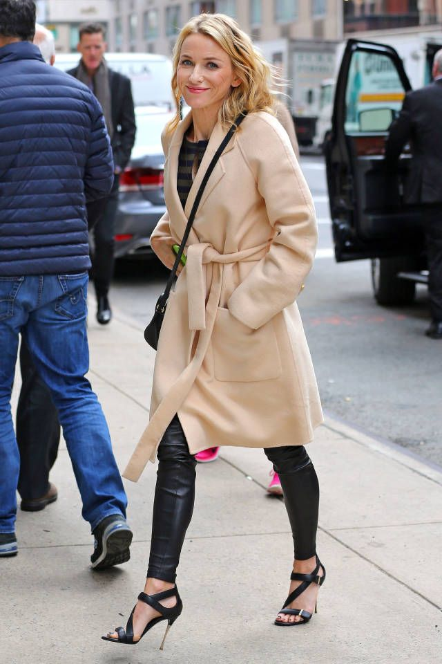 Naomi Watts is all about sumptuous textures in her leather leggings and plush camel coat.