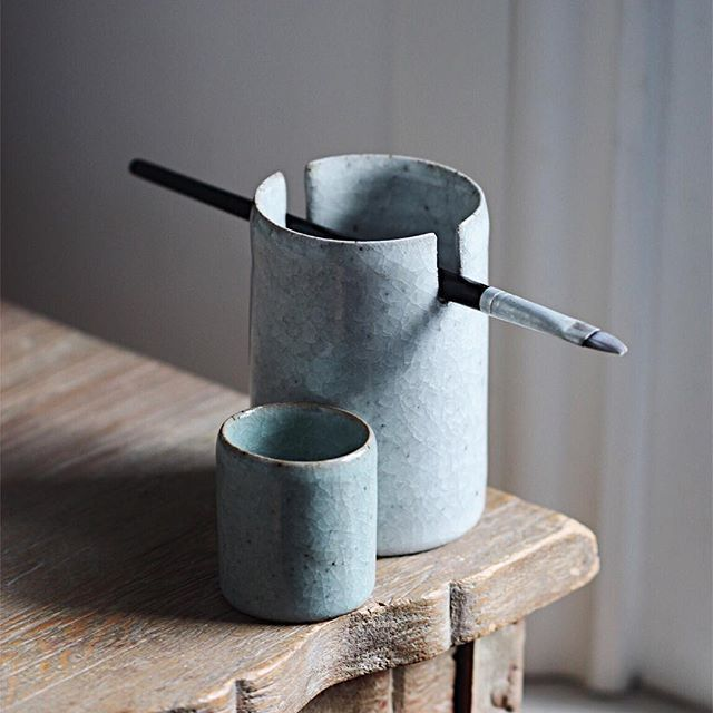 A brush-holder and waterpot, simple vessels that…