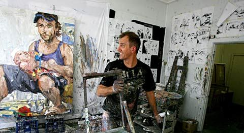 Nicholas Harding at his studio yesterday in Ultimo, Sydney, prepares another last touch to his Archibald entry portrait of Ben Quilty Picture: Sam Mooy