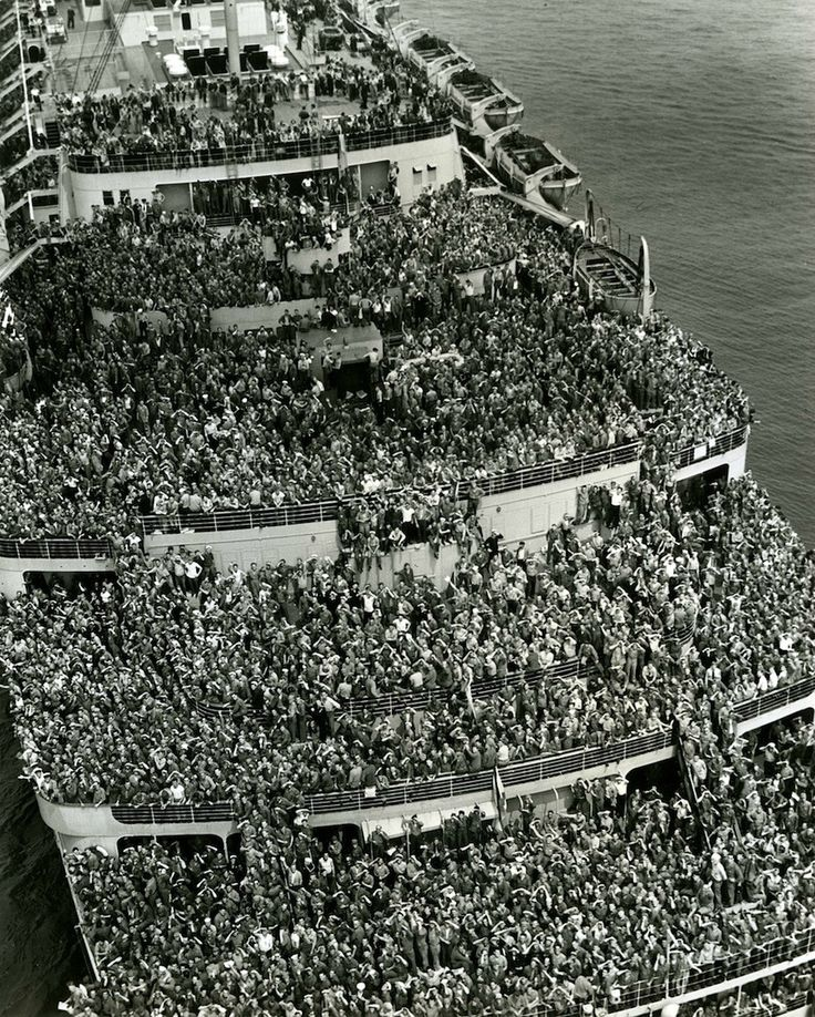 """The liner """"Queen Elizabeth"""" bringing American troops into NY Harbor at the end of WW II, 1945."""