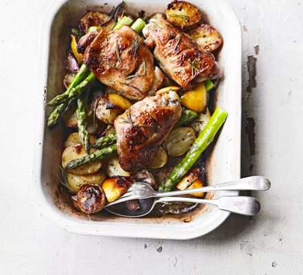An all-in-one lighter roast with Jersey Royals and a whole bulb of garlic - the potatoes catch the lemony cooking juices