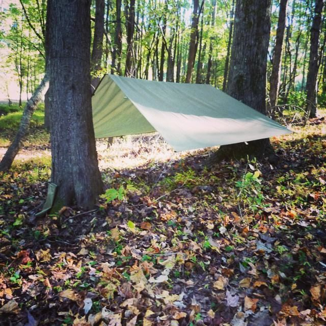 Compact Extremely Lightweight Tarp Shelter from 5col Survival Supply:  http://5col.com/products/5col-survival-supply-compact-extremely-lightweight-shelter-cels