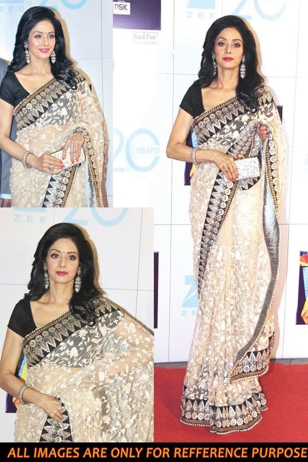 Latest Bollywood Replica Saree Sridevi Fabric - Tasar Color Bright Net with Heavy Work Blouse - Black Bhagalpuri Petticoat - Tasar (Creme) Satin Fabric http://vishawish.com/bollywood-replica/347-latest-bollywood-replica-saree-sridevi.html