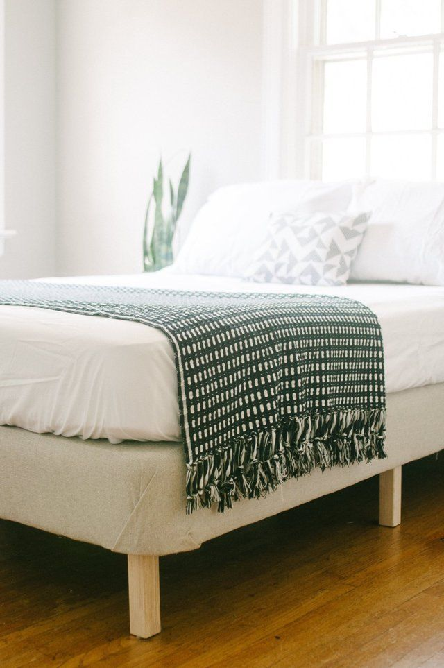 """This DIY project is a great use for older box springs, and an affordable way to have a """"brand new"""" bed. It only requires about four yards of upholstery fabric, and can be done in just a couple of hours..."""