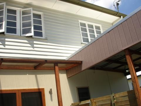 downstairs cladding - breaking up downstairs from upstairs - Latemore Design