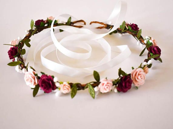 Gorgeous burgundy and blush handmade roses are delicately scattered about this petite rustic crown. The flexible base is covered in natural bark and intertwined with white berry vines and green leaf ribbons Perfect for a fall wedding, this crown would make a lovely accessory for any bride, bridesmaid, or flower girl. The colors photograph beautifully and would look equally as stunning in graduation, engagement, maternity and infant photo sessions. The crown is adjustable as it ties in the…