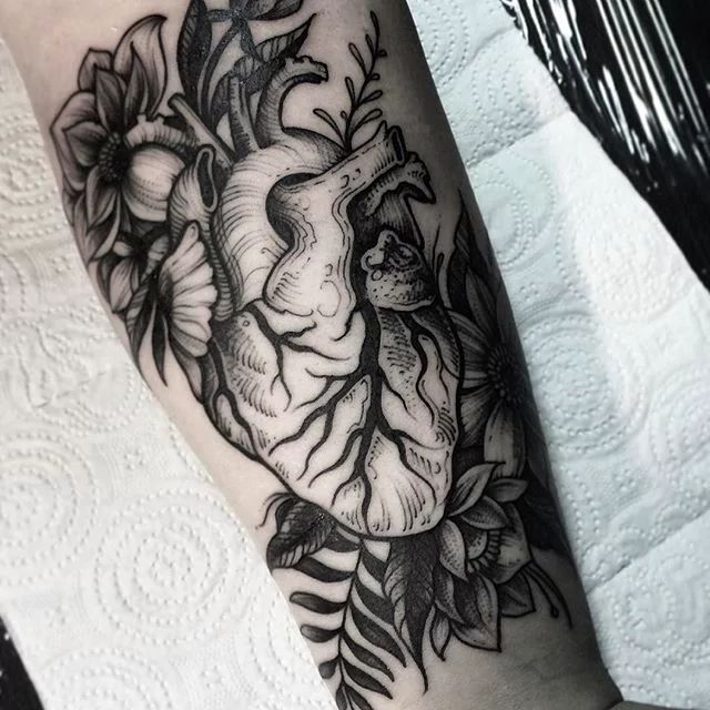 Anatomical heart with flowers tattoo.. DmitriyTkach heart blackwork anatomicalheart flower flowers