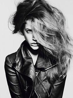 Headshot, black and white, model, leather jacket, big hair, shadows, love the one eye covered.
