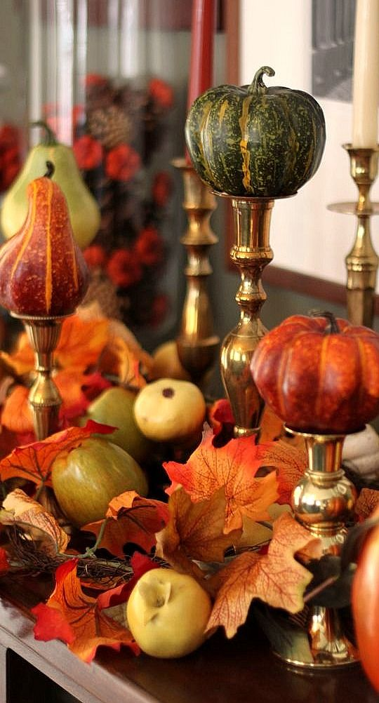 Love mixing it up with gourds and small pumpkins on some of the candle holders. | Buyer Select