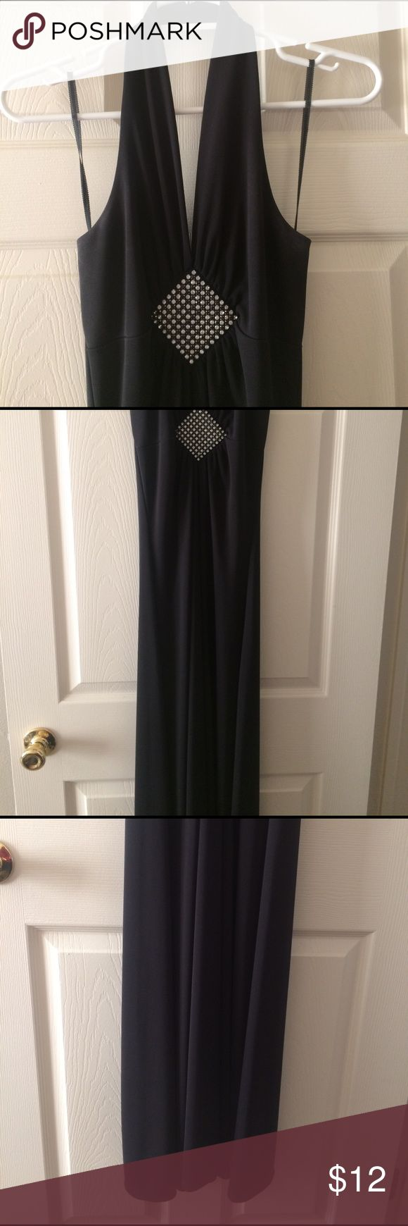 Long black elegant dress 👗 Simple yet gorgeous. Slide right in, no zippers or hooks which I like! Tighter fitting, halter top! I took a pic of the slit in the back of the dress! Perfect for formal wear, prom, etc! Worn once. *NOTE: one of the jewels is out as seen in pic*-probably an easy fix if you have a 💎jewel! Taboo Dresses Prom
