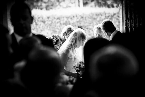 A quiet moment just before the bride enters the church - always a moment of expectation
