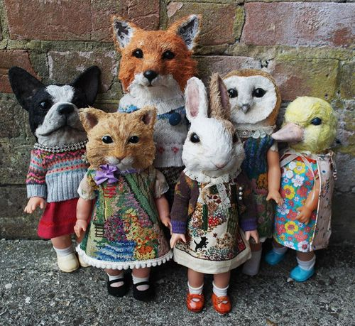 Annie Montgomerie's Textile Dolls: combines animal heads made from hardened shredded muslin with vintage doll bodies that are dressed with old clothes and accessories added.