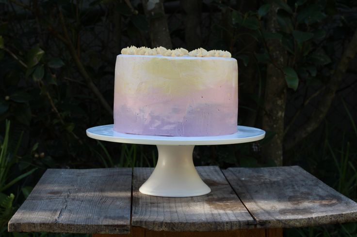 Dark chocolate cake with vanilla buttercream icing in sunset colours!