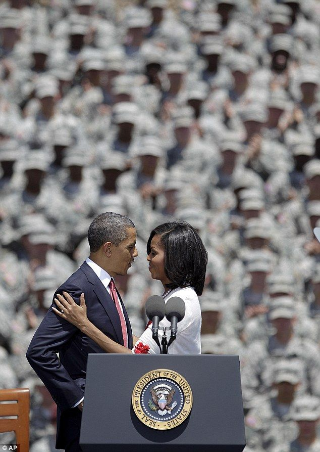 Shared moment: The President and his wife allow the crowd to see inside their relationship