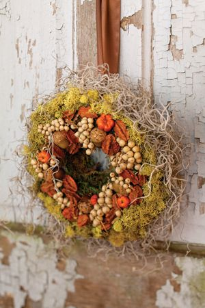 Spanish and reindeer mosses make a lush background for the tiny berries and seedpods decorating this wreath.
